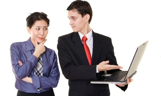 Woman and man discussing some info from laptop